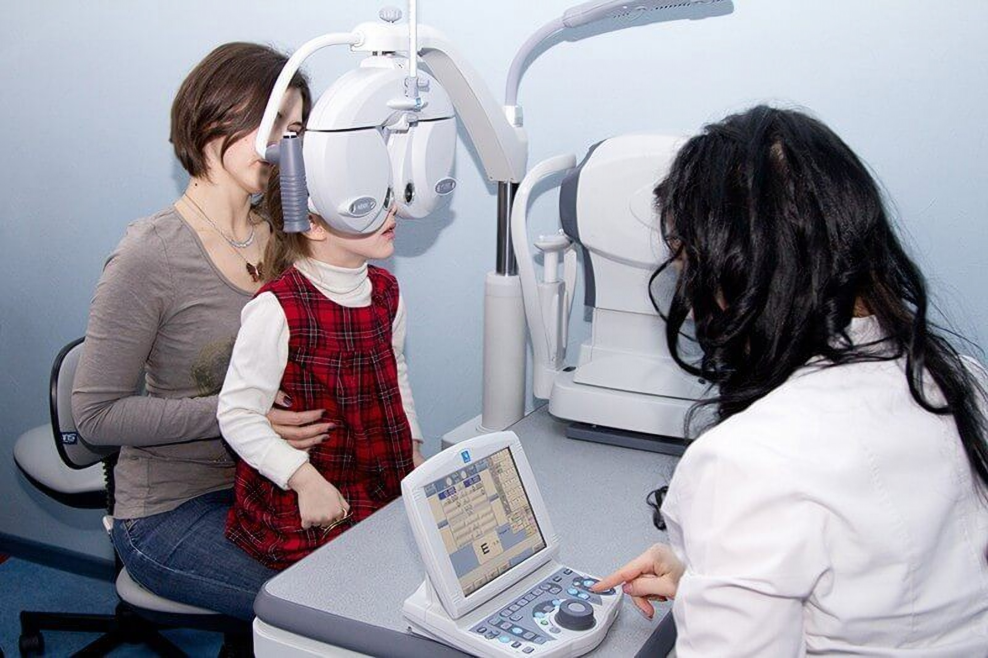 A girl with her mother at an eye examination by an Excimer ophthalmologist in Odessa