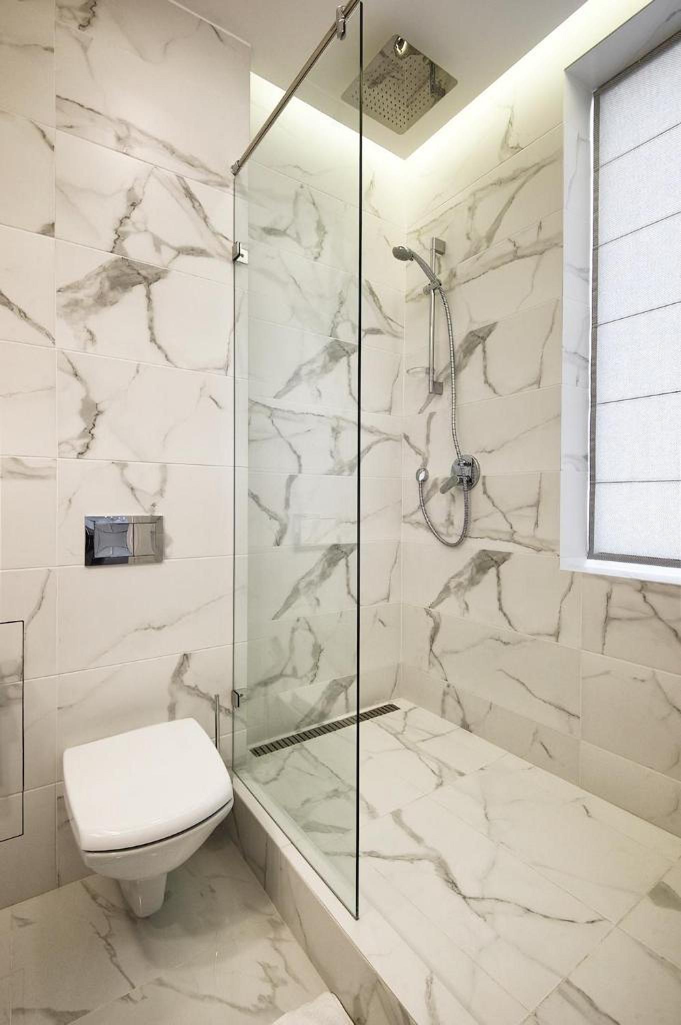Shower room at Allurapart Plaza Hotel
