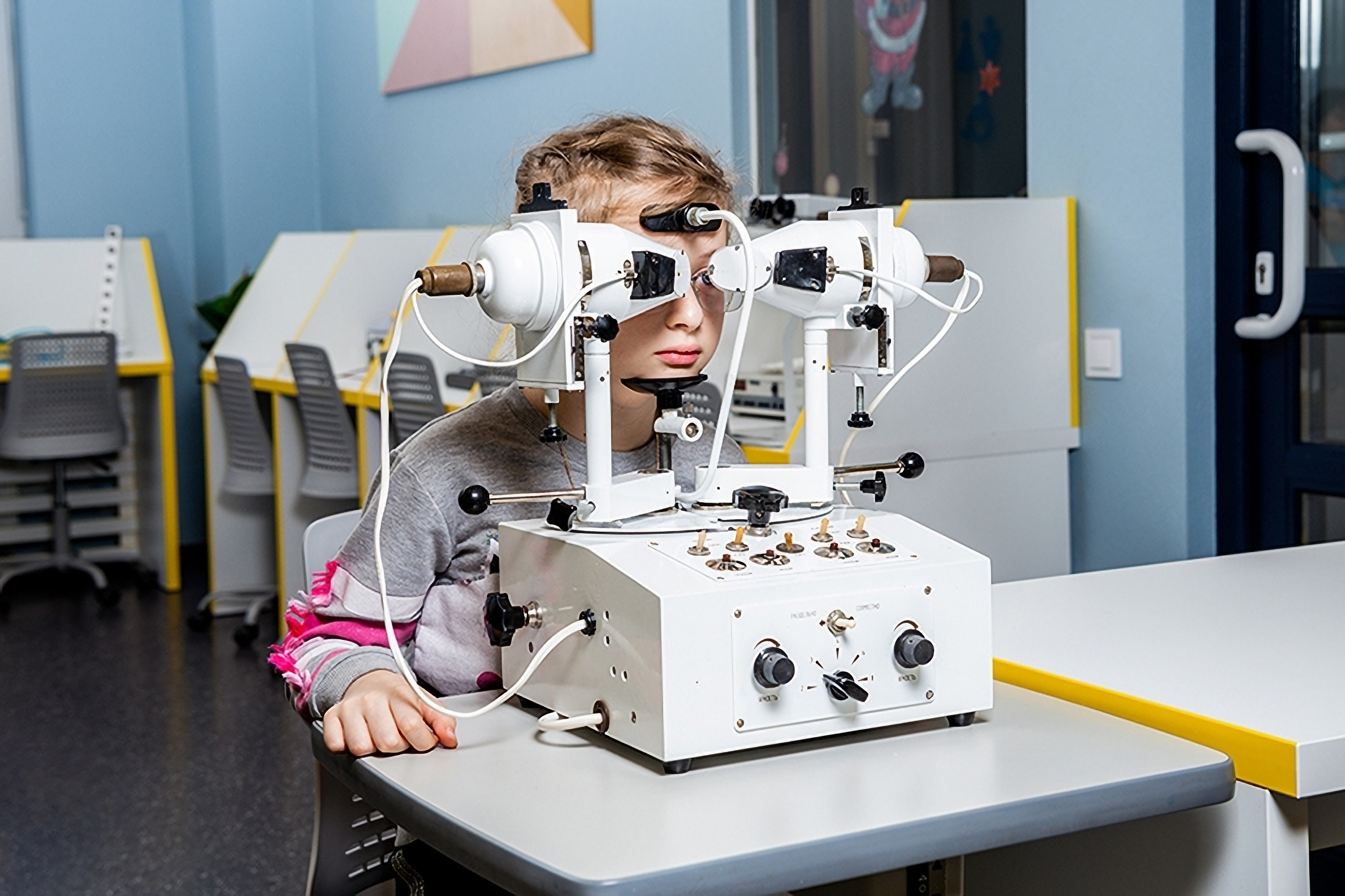 A child at an appointment with an Eximer ophthalmologist in Odessa