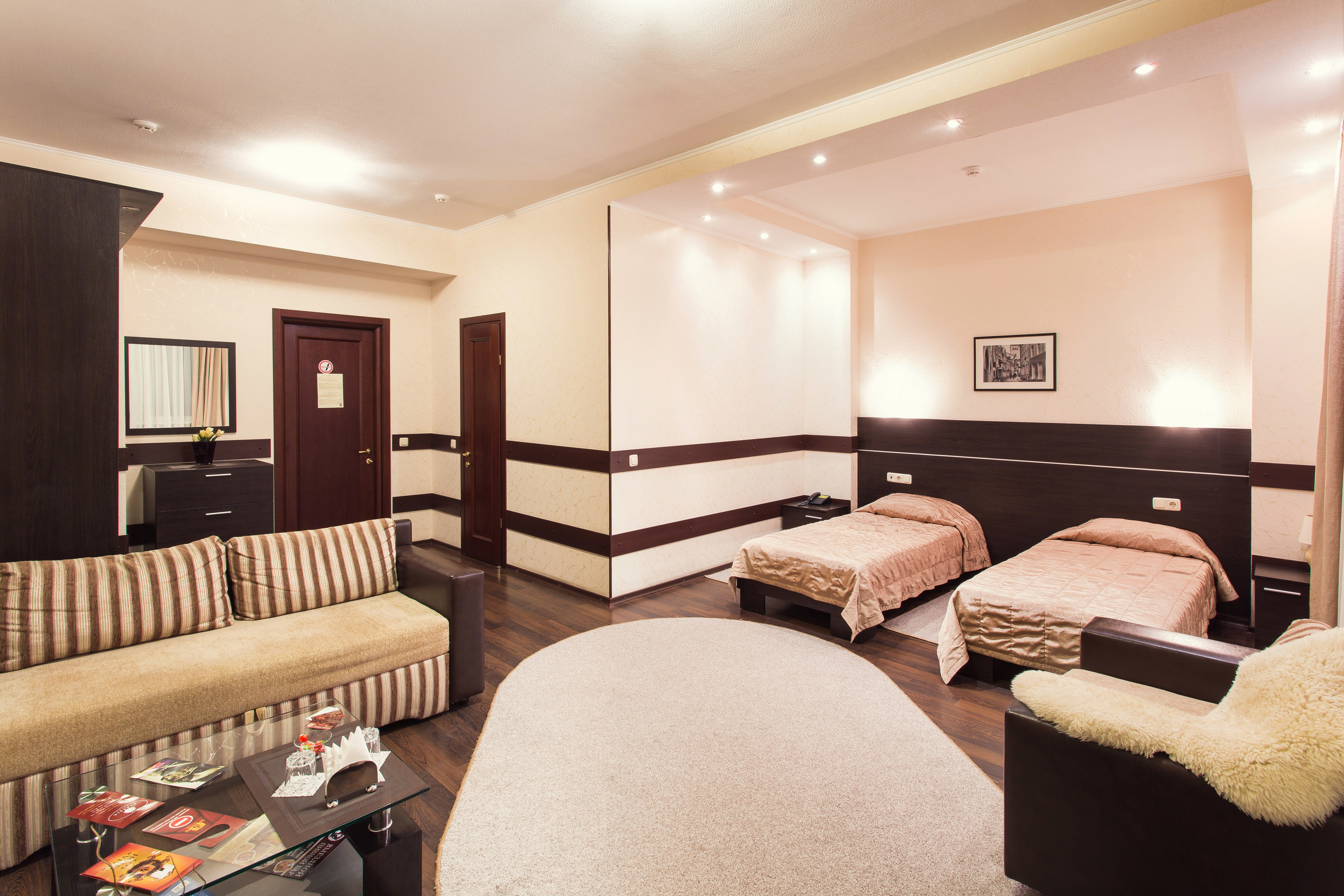 A room with two beds at Viva Hotel