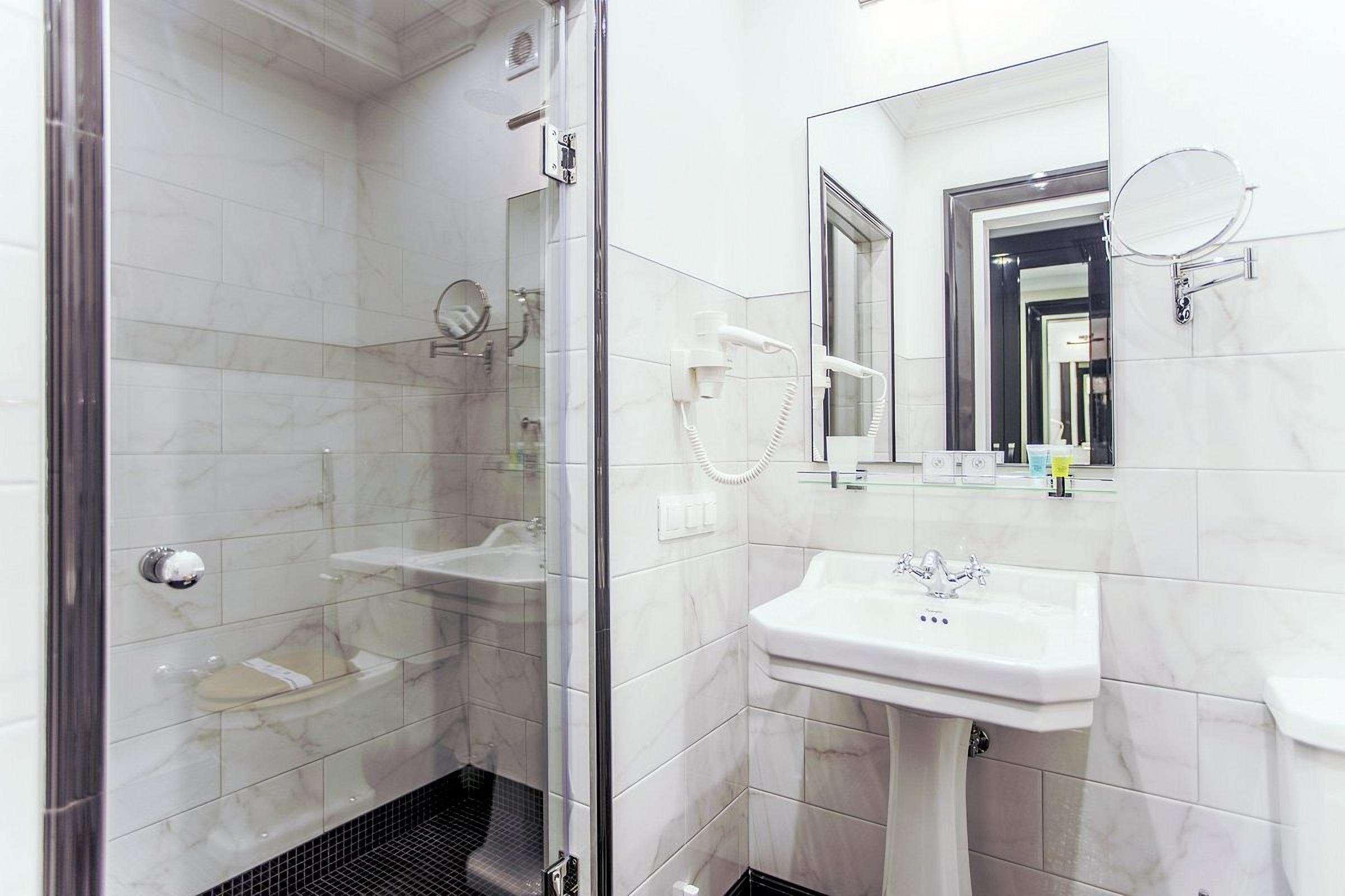 Shower cabin in a room at the Wall Street Hotel Odessa